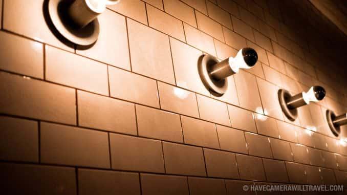 Modern lighting against white tile