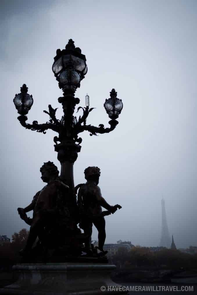 Rainy day in Paris with light post and Eiffel Tower